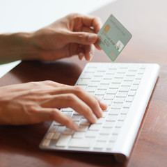 Typing credit card details at online shopping checkout