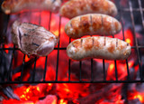 Meat and sausages on BBQ.
