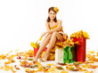 Woman autumn shopping in dress of maple leaves over white