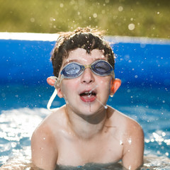 Portrait of a boy in a pool