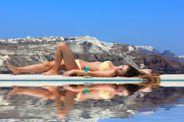 Young woman by the swimming pool Greece