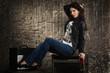 Pretty brunette woman in leather jacket