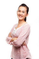 Asian woman smile with arms crossed while isolated