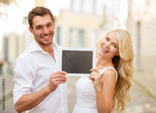 couple with tablet pc in the city