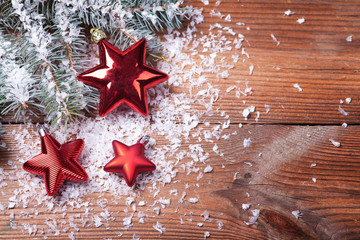 Christmas red stars on wooden background