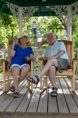 Senior Couple Resting  in the Gazebo