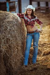 cowgirl model posing on farm