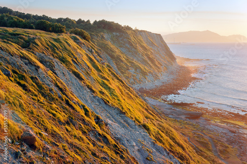 Cliffs of Azkorri beach at sunset