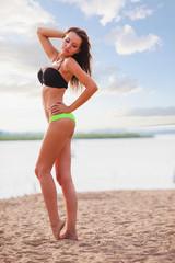 woman wearing bikini walking on beach
