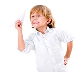 Boy playing with a paper plane