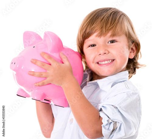 Boy holding a piggybank
