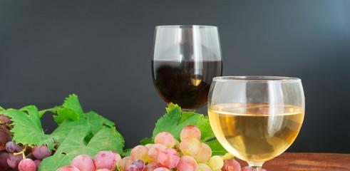 grape and wine on wood