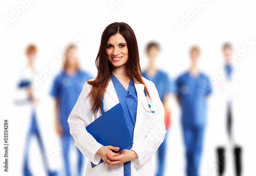Doctor in front of her medical team
