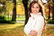 Smiling girl autumn park