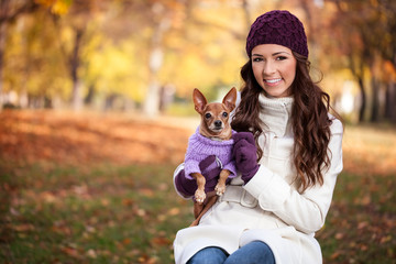 Happy woman with her little dog