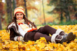 girl lying  autumn park