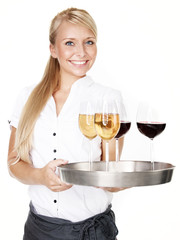 Pretty lady waitress with four glasses of wine