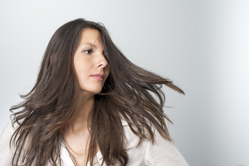 woman with healthy hair turns her head