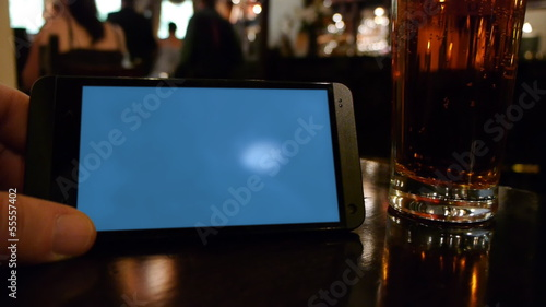 Smartphone template showing a blank screen in a pub.