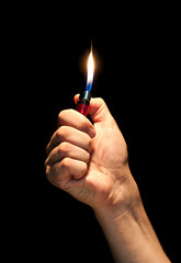 Man hand holding burning lighter