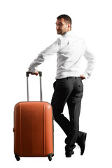 man holding suitcase and looking around