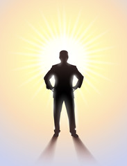 Silhouette of man standing in sunlight.