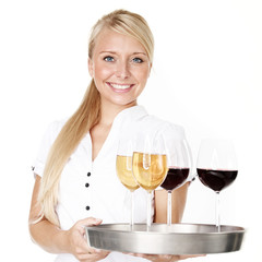 Smiling waitress serves wine glasses