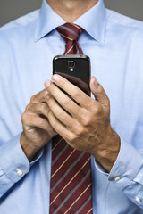 cropped portrait of businessman on mobile phone