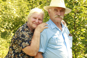 elderly couple in love outdoors