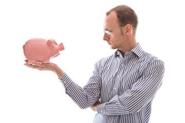 Mann isoliert mit Sparschwein überlegt - Geldanlage