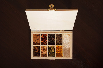 Wooden box full of spices, top view