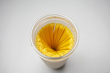 Top view of raw spaghetti swirl in a glass jar isolated in gray