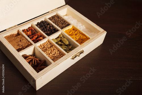 Wooden box full of spices, left aligned