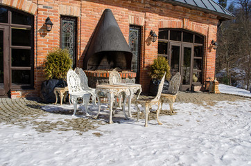 outdoor table chairs restaurant fireplace snow