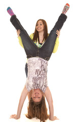 two girls handstand