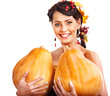 Woman holding autumn pumkin.