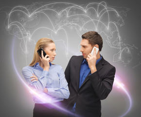 man and woman calling with smartphones