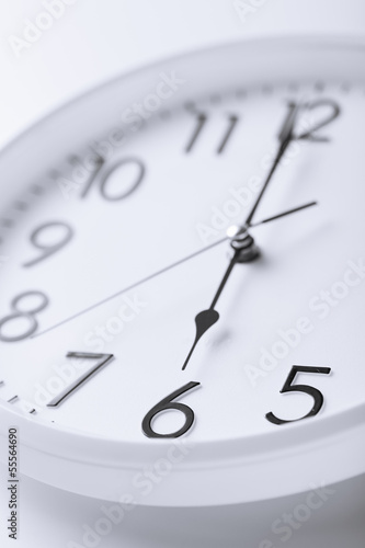 white clock showing six o'clock