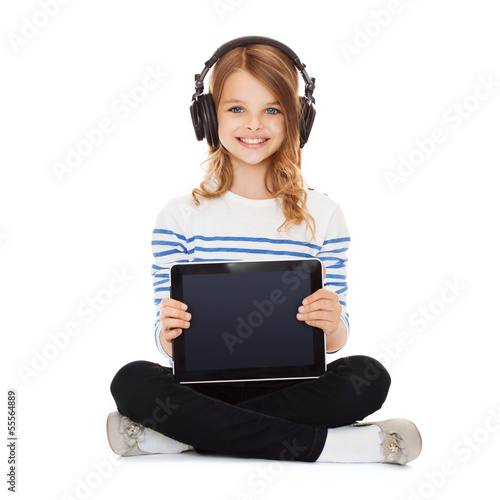 child with headphones showing tablet pc