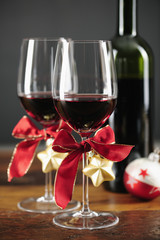 Two glasses of red wine with christmas ornaments