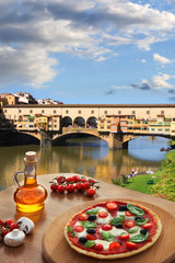 Florence with Vecchio bridge and Italian pizza in Tuscany, Italy
