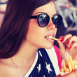 Beautiful young american girl eating french fries