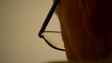Close up face with glasses craftsman rear view