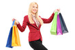 Blond smiling woman holding shopping bags