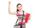 Happy female student holding notebooks