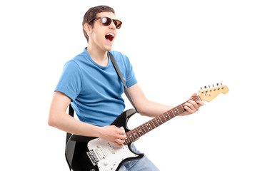 Guy playing on an electric guitar