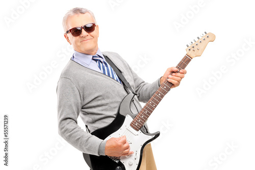 Smiling mature man playing guitar