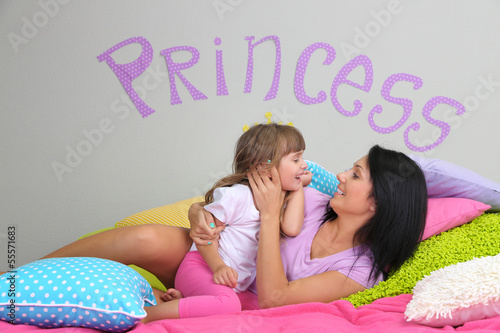 Little girl with mom lying