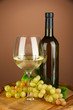 Composition of wine bottle, glass of white wine, grape