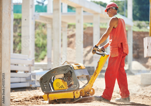 worker with compaction machine